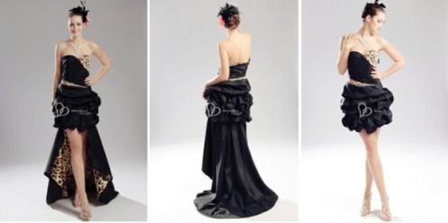 8dd6981bf65 Une robe de soirée 2 en 1 noire et à motifs félines. Cette robe de soirée  longue drapée peut aussi ...